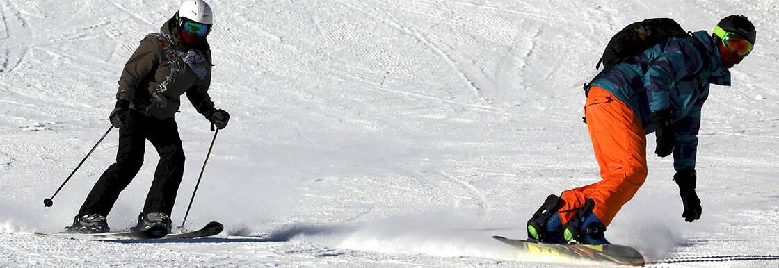 descente skieur snowboardeur